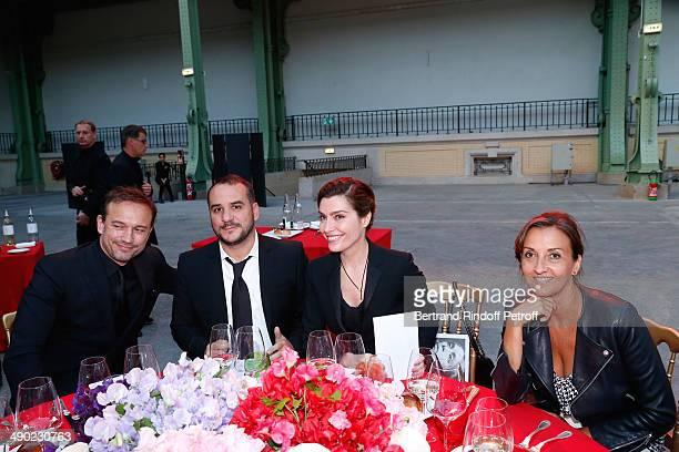 Felicitators sale Vincent Perez Francois Xavier Demaison his wife Emmanuelle and Daphne Roulier attend 'The strange city' Exhibition by Ilya and...