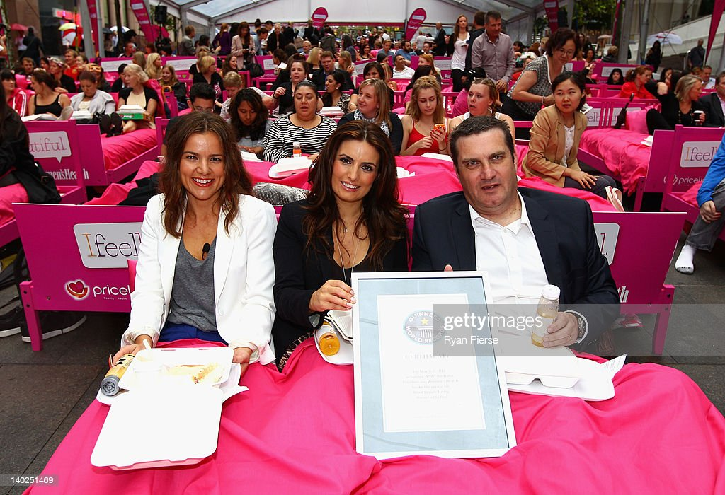 Felicity Harley, <a gi-track='captionPersonalityLinkClicked' href=/galleries/search?phrase=Ada+Nicodemou&family=editorial&specificpeople=209313 ng-click='$event.stopPropagation()'>Ada Nicodemou</a> and Stephen Roche attend The World's Biggest Breakfast in Bed Guinness World Record Attempt at Martin Place on March 2, 2012 in Sydney, Australia.