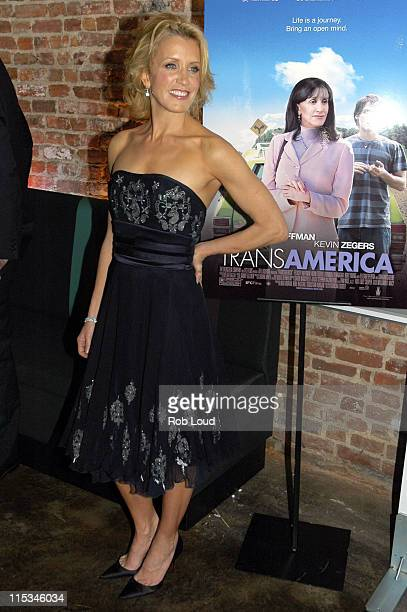 Felicity Huffman wearing a navy corseted cocktail dress by Marchesa