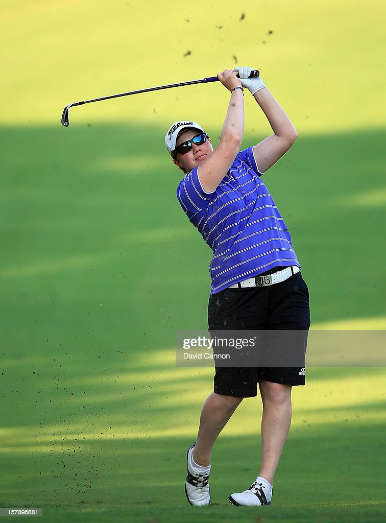 Felicity Johnson of England plays her second shot at the par 4, 14th hole during the third round of the 2012 Omega Dubai Ladies Masters on the Majilis Course at the Emirates Golf Club on December 7, 2012 in Dubai, United Arab Emirates.