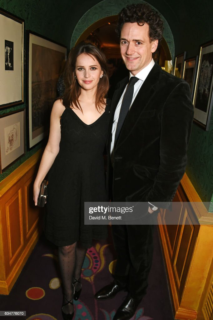 felicity-jones-and-charles-guard-attend-a-pre-bafta-party-hosted-by-picture-id634776070