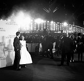 Felicity Jones and Eddie Redmayne attend the UK Premiere of 'The Theory Of Everything' at Odeon Leicester Square on December 9 2014 in London England
