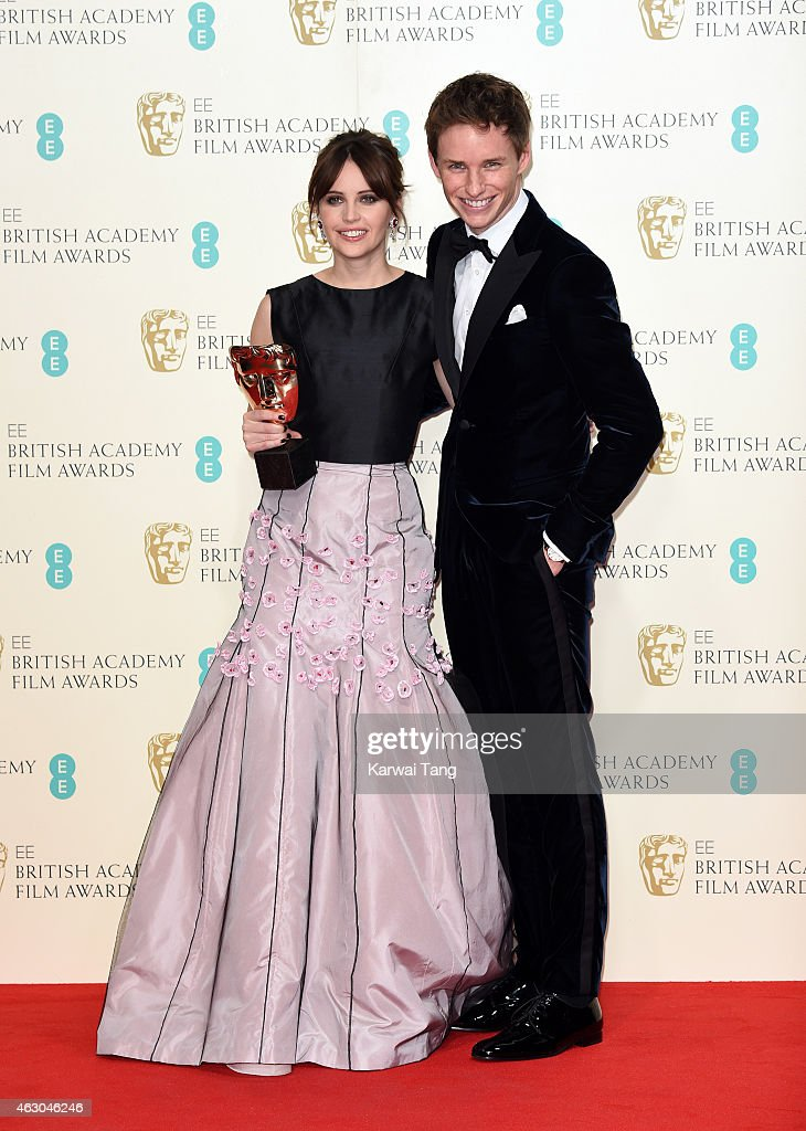 Felicity Jones (L) and Eddie Redmayne pose with the Outstanding British Film award for 'The Theory of Everything' in the winners room at the EE British Academy Film Awards at The Royal Opera House on February 8, 2015 in London, England.
