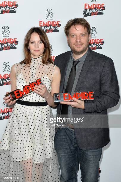 Felicity Jones and Gareth Edwards pose in the winners room with the awards for Best Actress and Best Film at the THREE Empire awards at The...