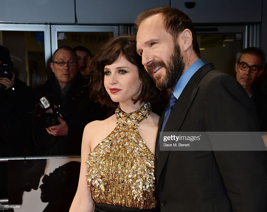 Felicity Jones (L) and Ralph Fiennes attend the UK Premiere of 'The Invisible Woman' at the ODEON Kensington on January 27, 2014 in London, England.