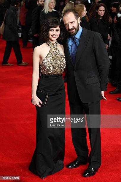 Felicity Jones and Ralph Fiennes attend the UK Premiere of 'The Invisible Woman' at ODEON Kensington on January 27 2014 in London England