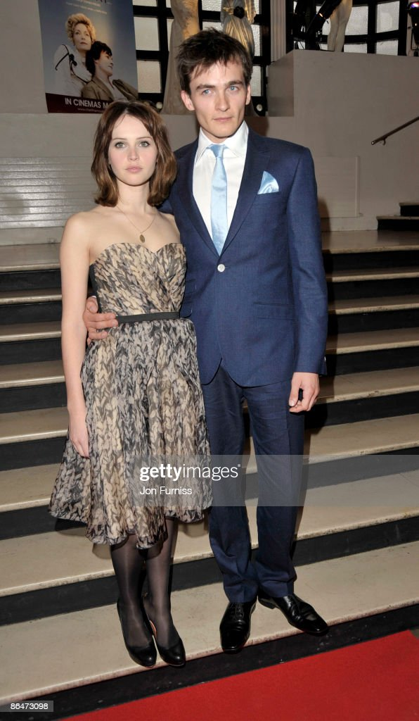 <a gi-track='captionPersonalityLinkClicked' href=/galleries/search?phrase=Felicity+Jones&family=editorial&specificpeople=5128418 ng-click='$event.stopPropagation()'>Felicity Jones</a> and Rupert Friend attends the UK premiere of 'Cheri' at Cine lumiere on May 6, 2009 in London, England.