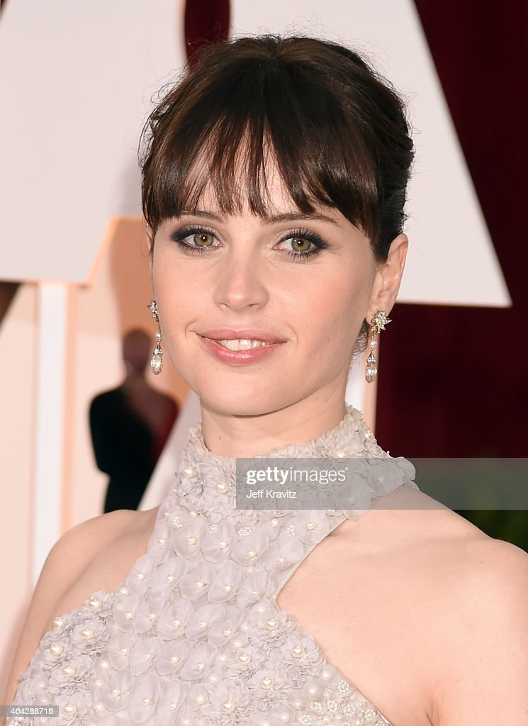 Felicity Jones attends the 87th Annual Academy Awards at Hollywood Highland Center on February 22 2015 in Hollywood California