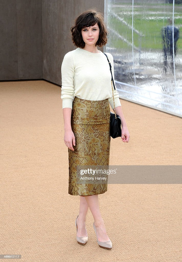 Felicity Jones attends the Burberry Prorsum show at London Fashion Week AW14 at Kensington Gardens on February 17, 2014 in London, England.