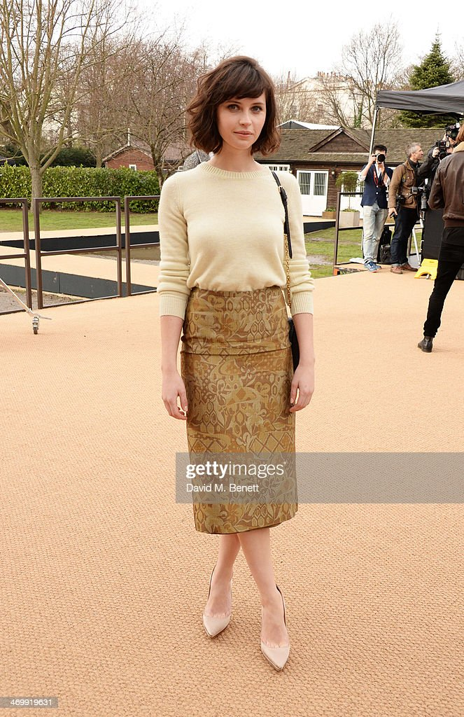 Felicity Jones carrives at Burberry Womenswear Autumn/Winter 2014 at Kensington Gardens on February 17, 2014 in London, England.
