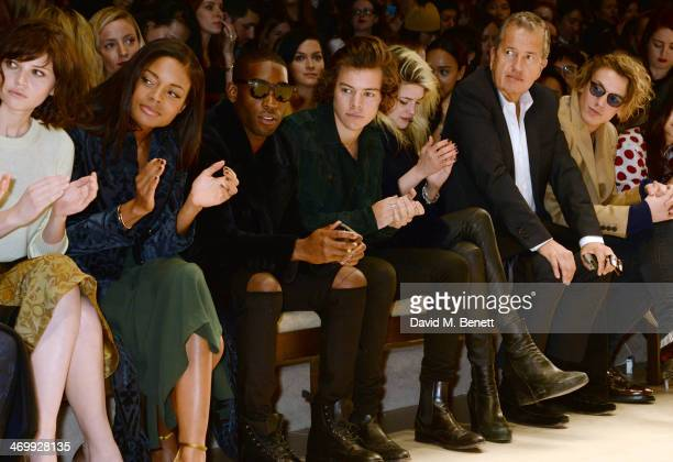 Felicity Jones Naomie Harris Tinie Tempah Harry Styles Alison Mosshart Mario Testino Jamie Campbell Bower and Angelababy attendsthe front row at...