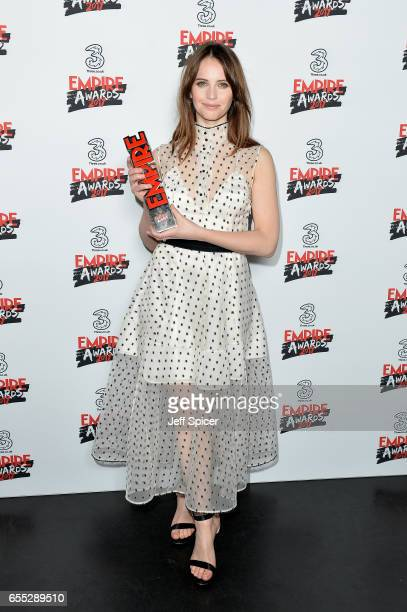 Felicity Jones winner of Best Actresss poses in the winners room at the THREE Empire awards at The Roundhouse on March 19 2017 in London England