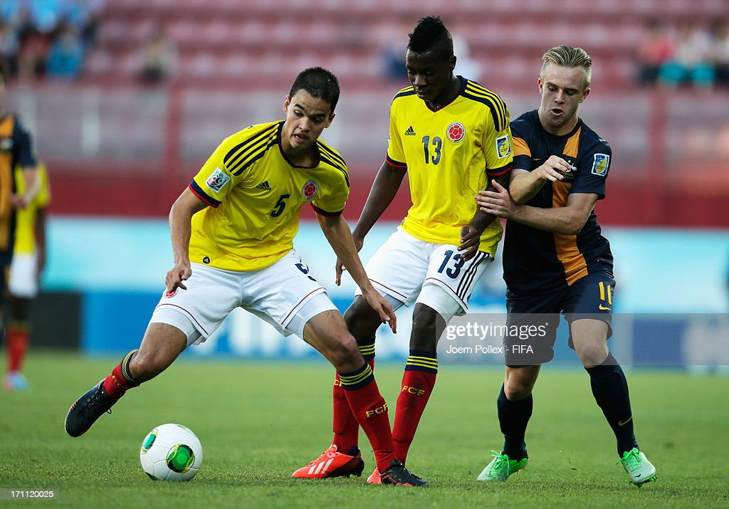 Felipe Aguilar (L) and Helibelton Palacios (C) of Colombia and Connor Pain of Australia compete for the ball during the FIFA U-20 World Cup Group C match between Colombia and Australia at Huseyin Avni Aker Stadium on June 22, 2013 in Trabzon, Turkey.