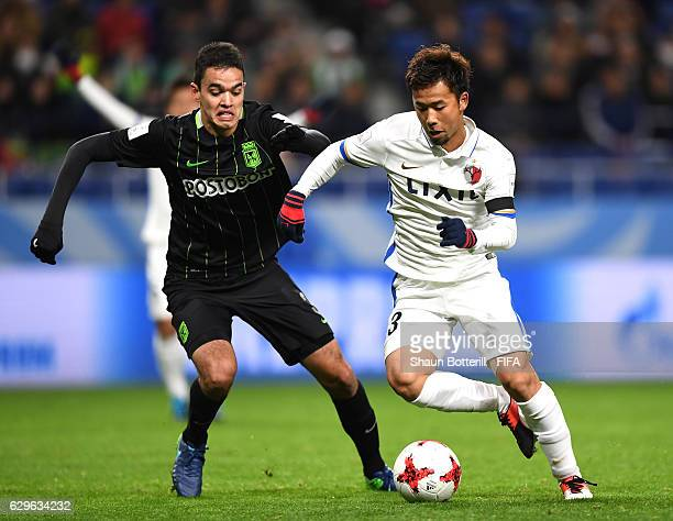 Felipe Aguilar of Atletico Nacional closes down Gen Shoji of Kashima Antlers during the FIFA Club World Cup Semi Final match between Atletico...