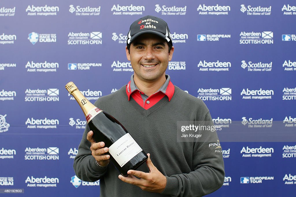 <a gi-track='captionPersonalityLinkClicked' href=/galleries/search?phrase=Felipe+Aguilar&family=editorial&specificpeople=562693 ng-click='$event.stopPropagation()'>Felipe Aguilar</a> of Chile celebrates during the presentation honoring him for his hole-in-one on the third hole during the second round of the Aberdeen Asset Management Scottish Open at Gullane Golf Club on July 10, 2015 in Gullane, East Lothian, Scotland.