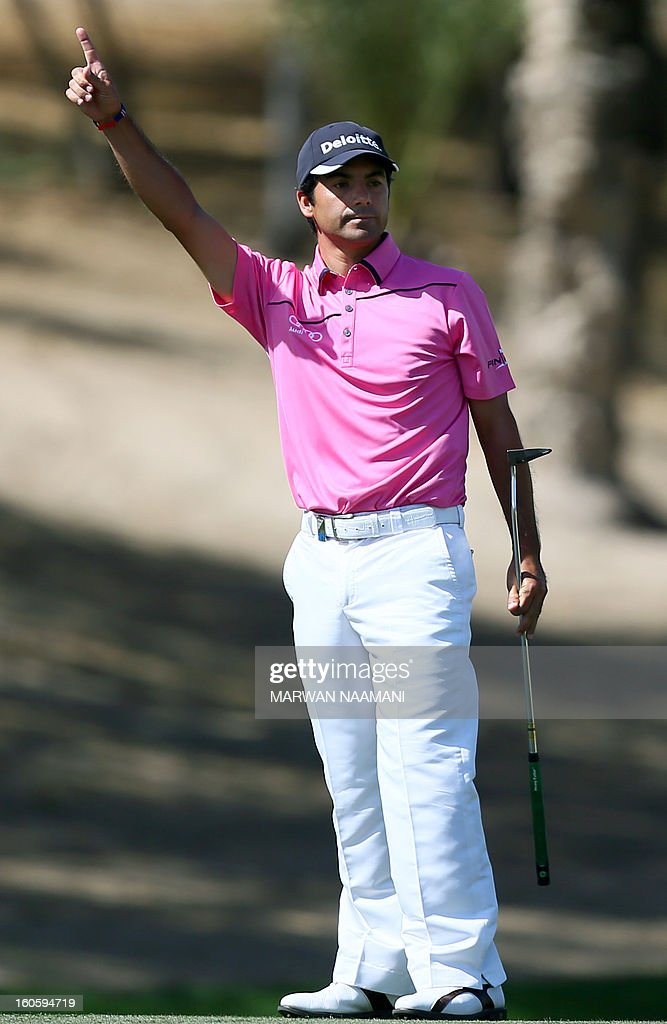 Felipe Aguilar of Chile gestures after making a birdie on the fourth and last round of the Omega Dubai Desert Classic in Dubai, on February 3, 2013. Stephen Gallacher of Scotland fired a timely eagle two on the par-4 16th hole and comfortably won the $2.5 million Omega Dubai Desert Classic in the end by three shots. AFP PHOTO/MARWAN NAAMANI