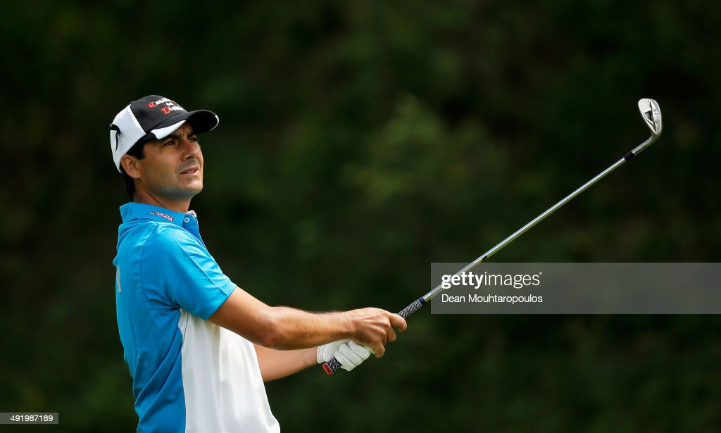 <a gi-track='captionPersonalityLinkClicked' href=/galleries/search?phrase=Felipe+Aguilar&family=editorial&specificpeople=562693 ng-click='$event.stopPropagation()'>Felipe Aguilar</a> of Chile hits his second shot on the 1st hole during the final round of the Open de Espana held at PGA Catalunya Resort on May 18, 2014 in Girona, Spain.