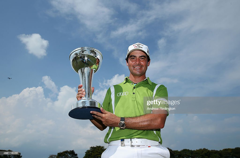 <a gi-track='captionPersonalityLinkClicked' href=/galleries/search?phrase=Felipe+Aguilar&family=editorial&specificpeople=562693 ng-click='$event.stopPropagation()'>Felipe Aguilar</a> of Chile poses with the trophy after winning The Championship at Laguna National held at Laguna National Golf & Country Club on May 4, 2014 in Singapore.