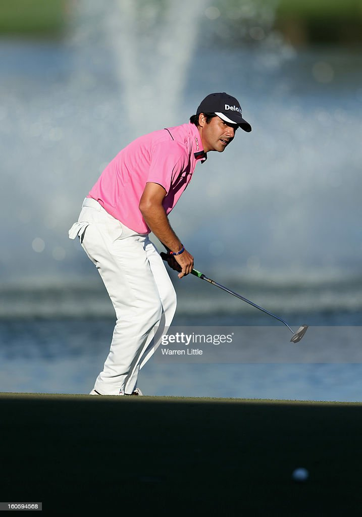 Felipe Aguilar of Chile reacts after missing a putt on the 18th green during the final round of the Omega Dubai Desert Classic at Emirates Golf Club on February 3, 2013 in Dubai, United Arab Emirates.