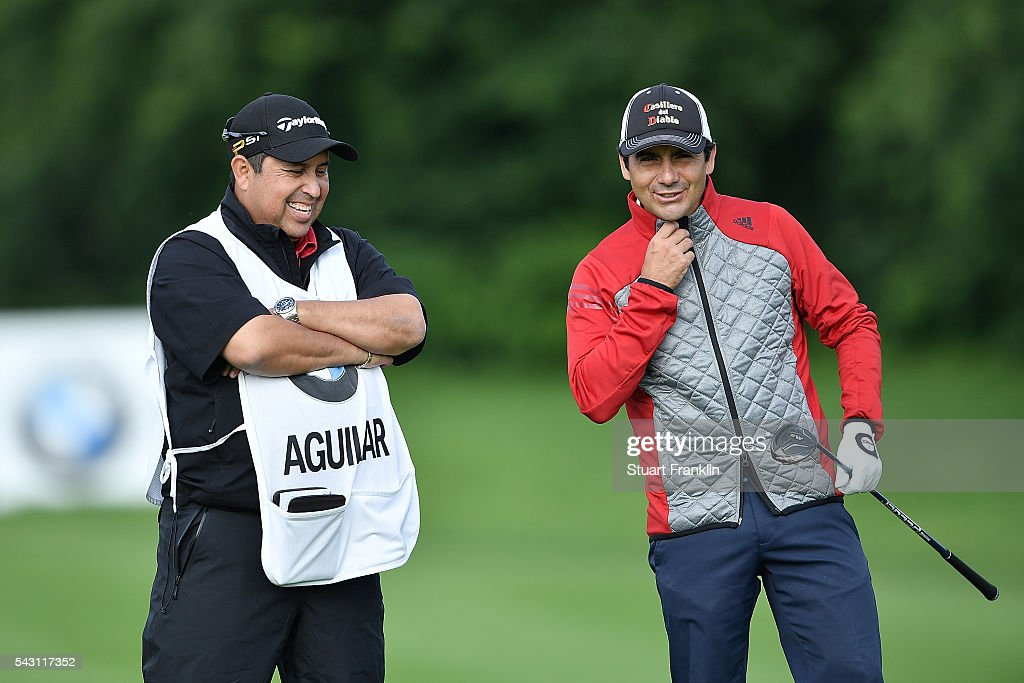 <a gi-track='captionPersonalityLinkClicked' href=/galleries/search?phrase=Felipe+Aguilar&family=editorial&specificpeople=562693 ng-click='$event.stopPropagation()'>Felipe Aguilar</a> of Chile reacts with his caddie during the rain delayed third round of the BMW International Open at Gut Larchenhof on June 26, 2016 in Cologne, Germany.