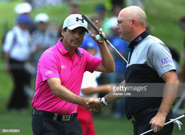 Felipe Aguilar of Chile shakes hands with Graeme Storm of England on the 18th green during the third roud of the Lyoness Open at Diamond Country Club...