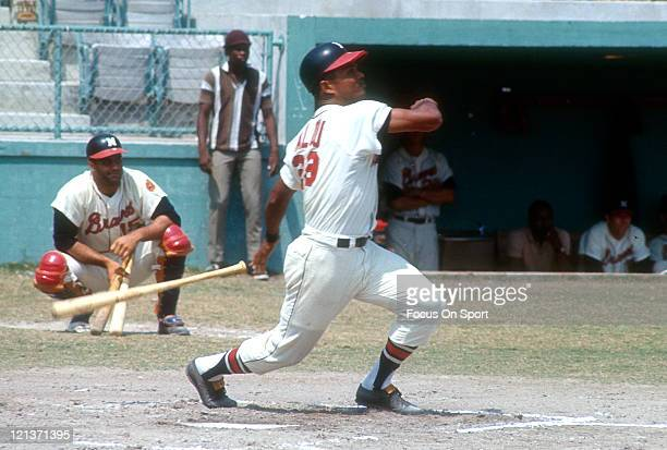 Felipe Alou of the Milwaukee Braves bats during an Major League Baseball game circa 1965 at Milwaukee County Stadium in Milwaukee Wisconsin Alou...