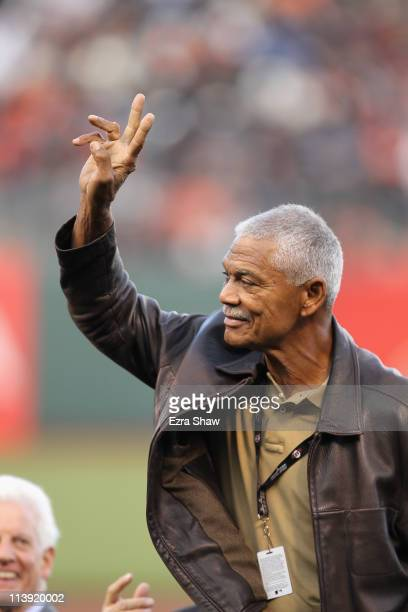 Felipe Alou waves to the crowd during a ceremony for Willie Mays' 80 birthday before the San Francisco Giants game against the Colorado Rockies at...