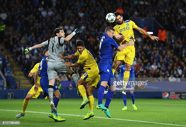 Felipe and Iker Casillas of FC Porto defend against Robert Huth of Leicester City during the UEFA Champions League Group G match between Leicester...