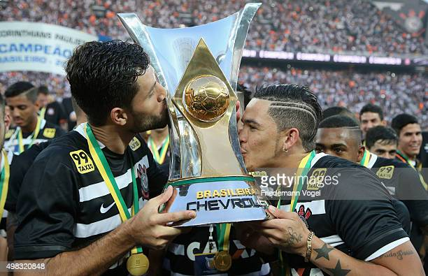 Felipe and Luciano of Corinthians celebrates with the trophy after winning the match between Corinthians and Sao Paulo for the Brazilian Series A...