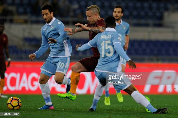 Felipe Anderson and Quissanga Bastos of SS Lazio compete for the ball with Radja Nainggolan of AS Roma during the TIM Cup match between SS Lazio and...