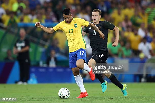 Felipe Anderson of Brazil holds off Lukas Klostermann of Germany during the Men's Football Final between Brazil and Germany at the Maracana Stadium...