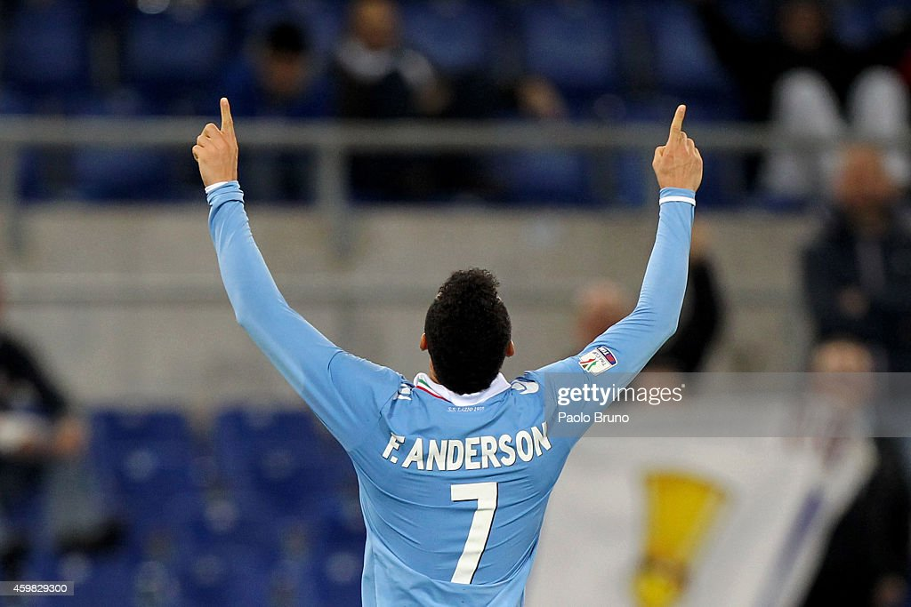 <a gi-track='captionPersonalityLinkClicked' href=/galleries/search?phrase=Felipe+Anderson&family=editorial&specificpeople=7358255 ng-click='$event.stopPropagation()'>Felipe Anderson</a> of SS Lazio celebrates after scoring the third team's goal during the TIM Cup match between SS Lazio and AS Varese at Stadio Olimpico on December 2, 2014 in Rome, Italy.