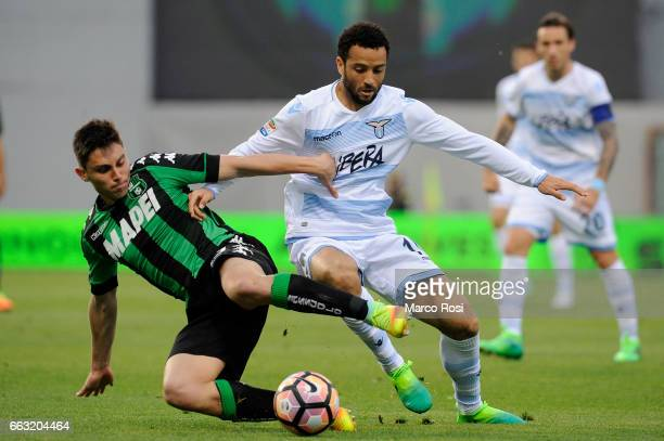 Felipe Anderson of SS Lazio compete for the ball with Cristian Dell'Orco of US Sassuolo during the Serie A match between US Sassuolo and SS Lazio at...