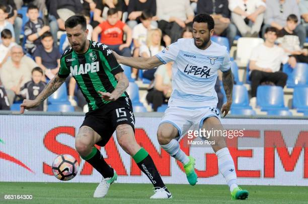Felipe Anderson of SS Lazio compete for the ball with Francesco Acerbi of US Sassuola during the Serie A match between US Sassuolo and SS Lazio at...