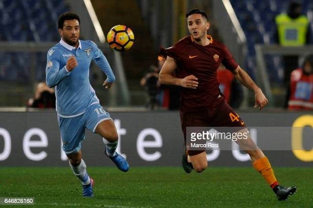 Felipe Anderson of SS Lazio compete for the ball with Kostas Manolas of AS Roma during the TIM Cup match between SS Lazio and AS Roma at Olimpico...