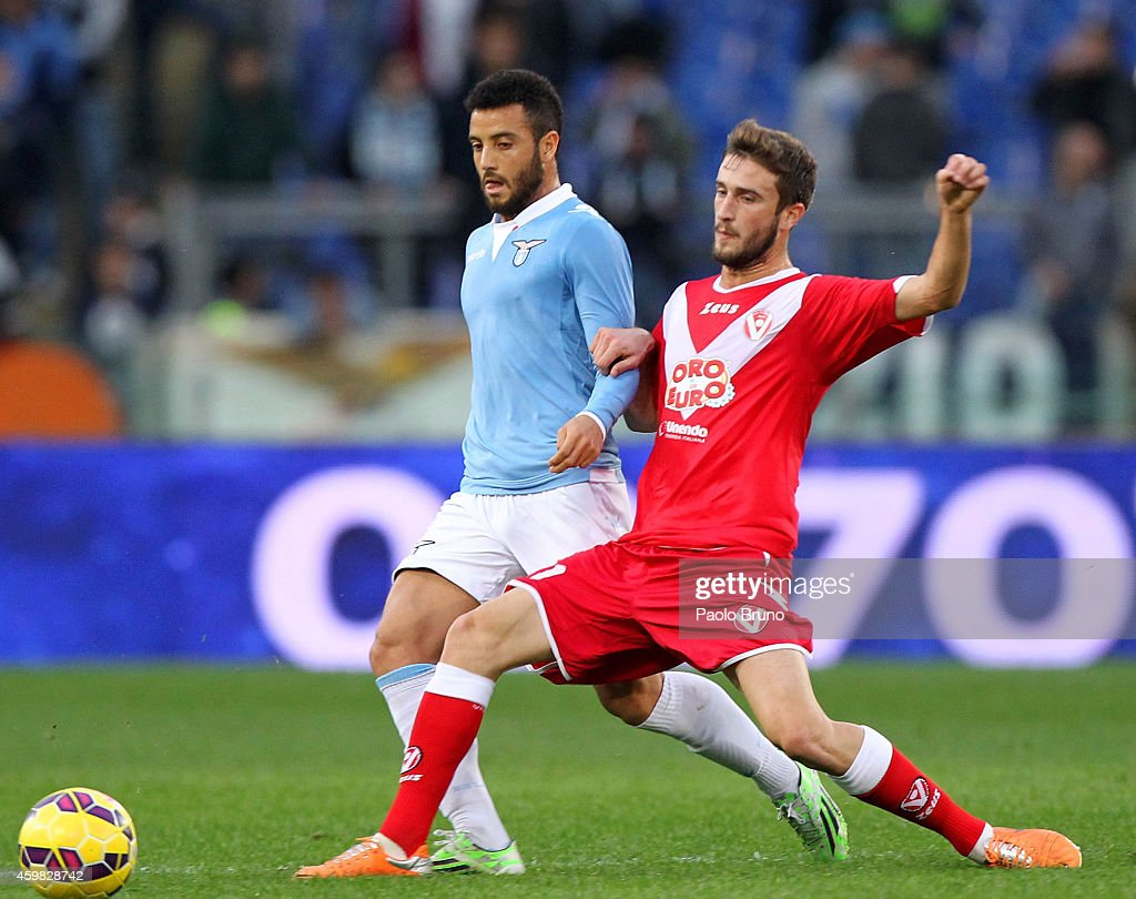 <a gi-track='captionPersonalityLinkClicked' href=/galleries/search?phrase=Felipe+Anderson&family=editorial&specificpeople=7358255 ng-click='$event.stopPropagation()'>Felipe Anderson</a> (L) of SS Lazio competes for the ball with <a gi-track='captionPersonalityLinkClicked' href=/galleries/search?phrase=Arturo+Lupoli&family=editorial&specificpeople=2142398 ng-click='$event.stopPropagation()'>Arturo Lupoli</a> of AS Varese during the TIM Cup match between SS Lazio and AS Varese at Stadio Olimpico on December 2, 2014 in Rome, Italy.