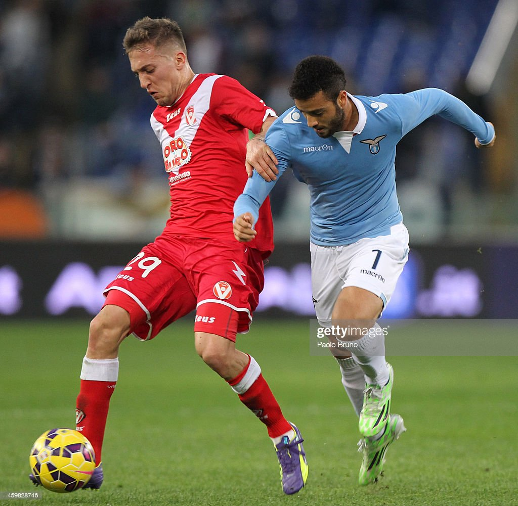 <a gi-track='captionPersonalityLinkClicked' href=/galleries/search?phrase=Felipe+Anderson&family=editorial&specificpeople=7358255 ng-click='$event.stopPropagation()'>Felipe Anderson</a> (R) of SS Lazio competes for the ball with <a gi-track='captionPersonalityLinkClicked' href=/galleries/search?phrase=Arturo+Lupoli&family=editorial&specificpeople=2142398 ng-click='$event.stopPropagation()'>Arturo Lupoli</a> of AS Varese during the TIM Cup match between SS Lazio and AS Varese at Stadio Olimpico on December 2, 2014 in Rome, Italy.