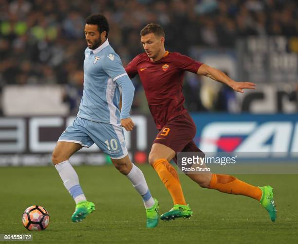 Felipe Anderson of SS Lazio competes for the ball with Edin Dzeko of AS Roma during the TIM Cup match between AS Roma and SS Lazio at Stadio Olimpico...