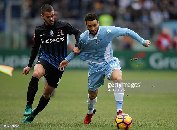Felipe Anderson of SS Lazio competes for the ball with Leonardo Spinazzola of Atalanta BC during the Serie A match between SS Lazio and Atalanta BC...