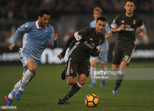 Felipe Anderson of SS Lazio competes for the ball with Leonel Vangioni of AC Milan during the Serie A match between SS Lazio and AC Milan at Stadio...