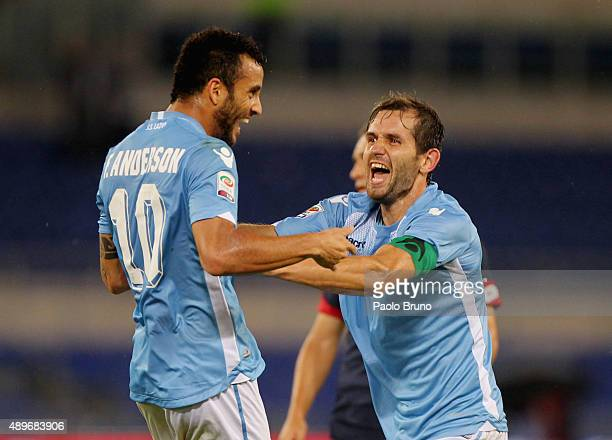 Felipe Anderson with his teammate Senad Lulic of SS Lazio celebrates after scoring the team's second goal during the Serie A match between SS Lazio...