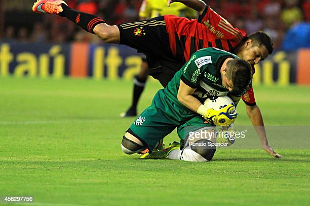 Felipe Azevedo of Sport Recife struggle for the ball with Tiago Volpi goalkeeper of Figueirense during the Brasileirao Series A 2014 match between...