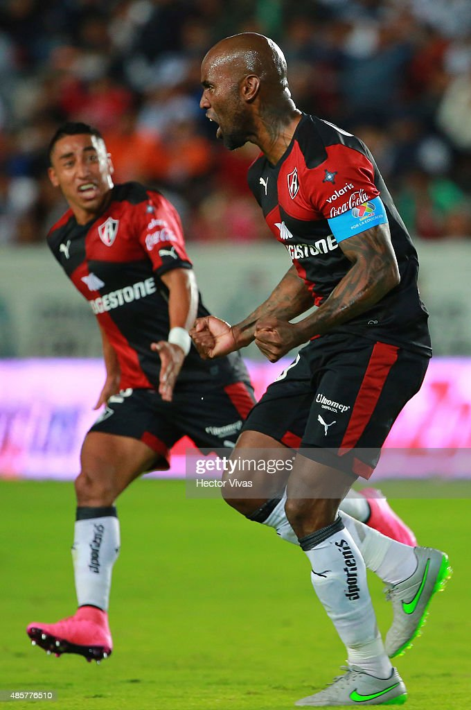 Felipe Baloy of Atlas celebrates after scoring the first goal of his team during a 7th round match between Pachuca and Atlas as part of the Apertura...