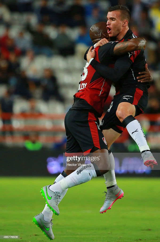 Felipe Baloy of Atlas celebrates with teammate after scoring the first goal of his team during a 7th round match between Pachuca and Atlas as part of...