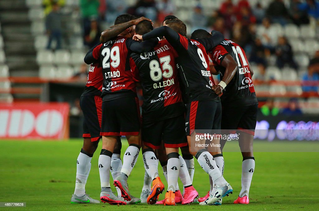 Felipe Baloy of Atlas celebrates with teammates after scoring the first goal of his team during a 7th round match between Pachuca and Atlas as part of the Apertura 2015 Liga MX at Hidalgo Stadium on August 29, 2015 in Pachuca, Mexico.