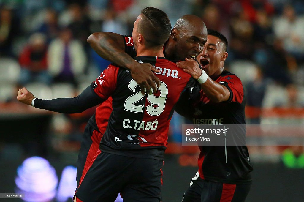 Felipe Baloy of Atlas celebrates with teammates after scoring the first goal of his team during a 7th round match between Pachuca and Atlas as part...