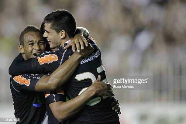 Felipe Bastos Fagner and Diego Souza of Vasco celebrate a scored goal againist Gremio during a match as part of Serie A 2011 at Sao Januario stadium...