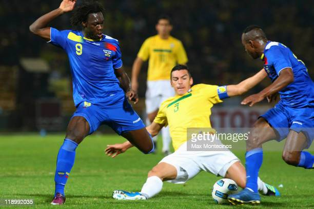 Felipe Caicedo from Ecuador fights for the ball with Lúcio from Brazil during a match between Brazil and Ecuador as part of the Group B of the Copa...