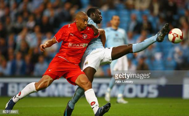 Felipe Caicedo of Manchester City stretches for the ball under pressure from Winston Reid of FC Midtjylland during the UEFA Cup 2nd Qualifying Round...