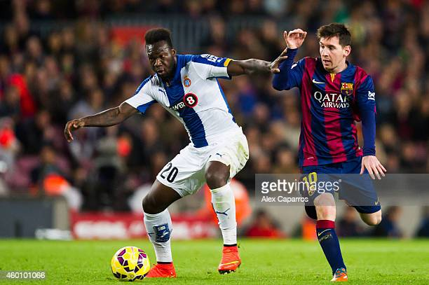 Felipe Caicedo of RCD Espanyol and Lionel Messi of FC Barcelona fight for the ball during the La Liga match between FC Barcelona and RCD Espanyol at...
